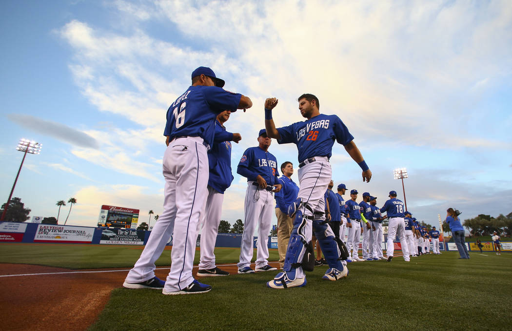 Las Vegas 51s catcher Kevin Plawecki (26) greets team manager Pedro Lopez (16) before the start of the opening day game against Fresno at Cashman Field in Las Vegas on Tuesday, April 11, 2017. Cha ...
