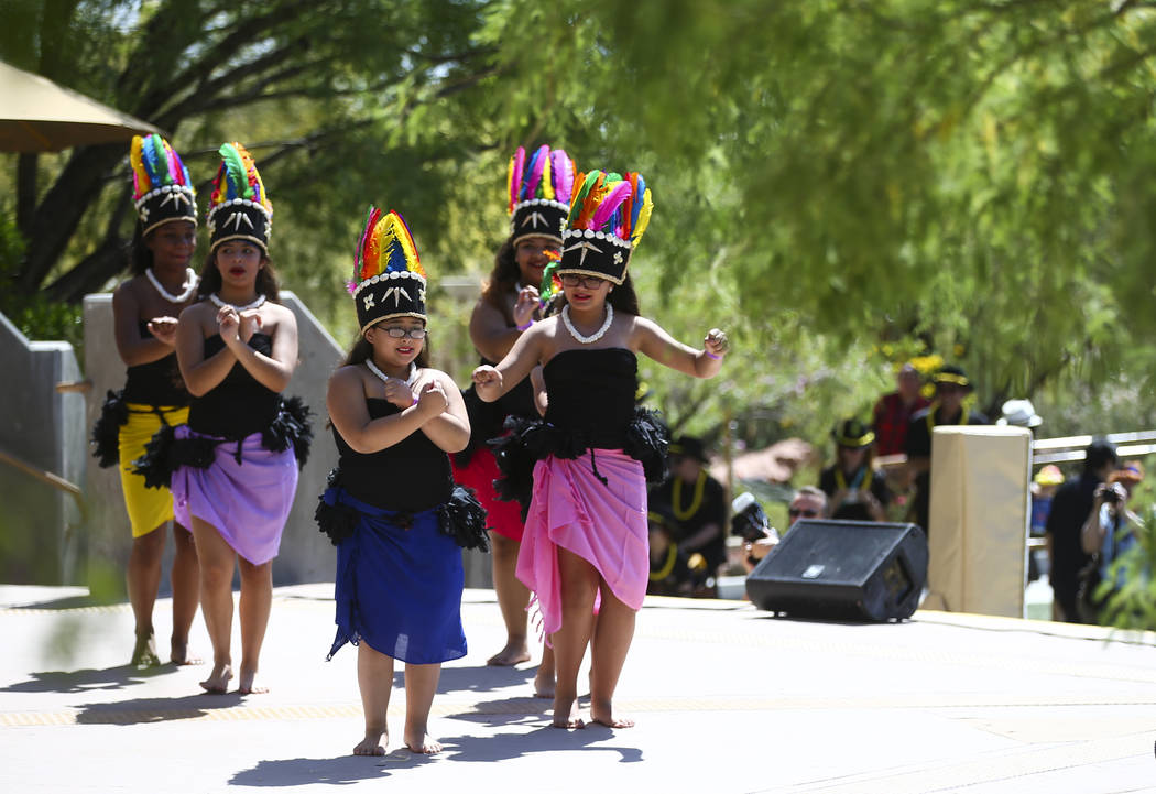 Members of the Heart of Polynesia dance troupe  perform during the 'Ohana Festival, celebrating Pacific Islander and Hawaiian cultures, at the Springs Preserve in Las Vegas on Saturday, May 6, 201 ...
