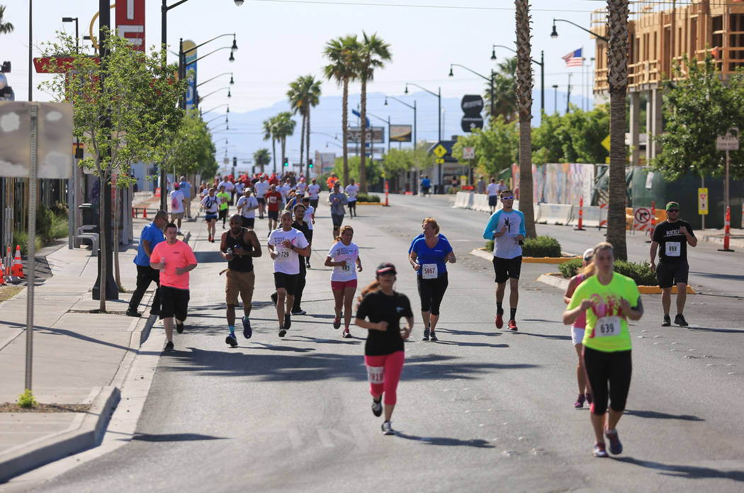 Runners head Fremont Street to the finish line of the Susan G. Komen Race for the Cure on Saturday, May 6, 2017, in Las Vegas. Brett Le Blanc Las Vegas Review-Journal @bleblancphoto