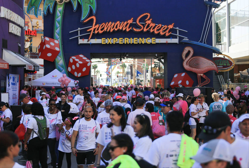 Runners and spectators walk along the Fremont Street Experience during the Susan G. Komen Race for the Cure on Saturday, May 6, 2017, in Las Vegas. Brett Le Blanc Las Vegas Review-Journal @bleblan ...