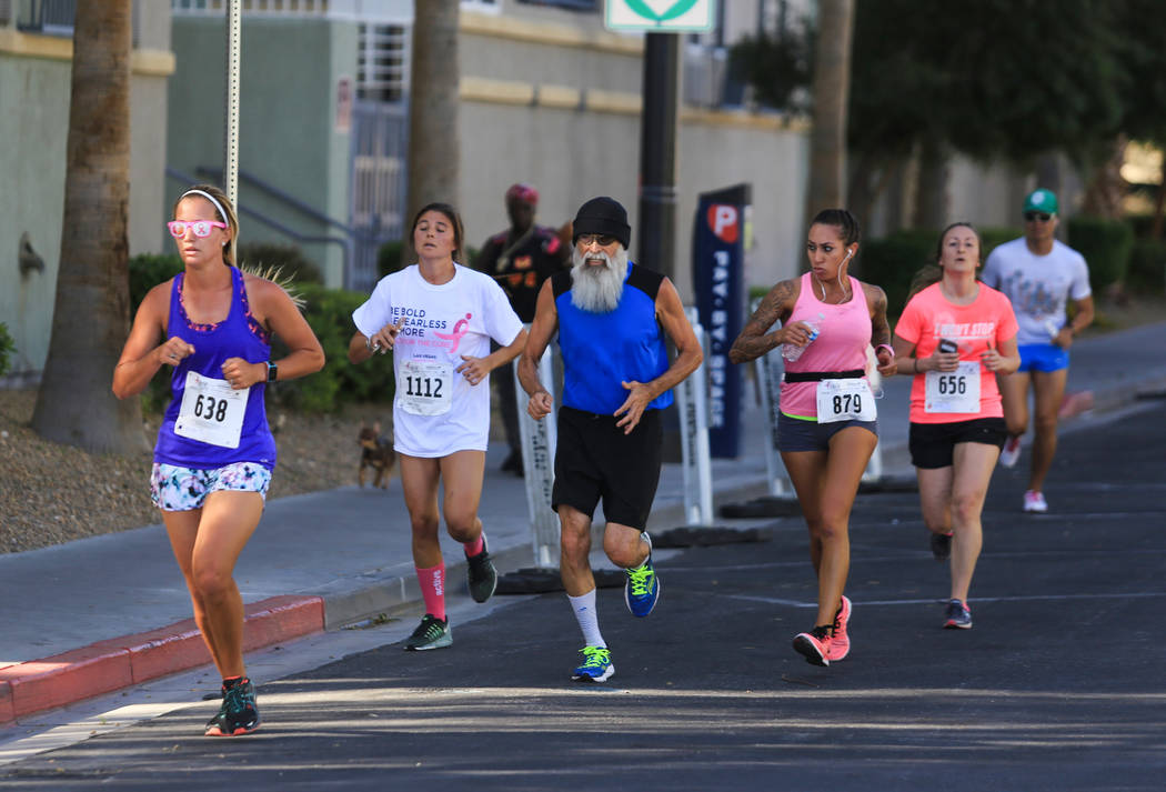 Runners participate in the 5K of the Susan G. Komen Race for the Cure on Saturday, May 6, 2017, in Las Vegas. Brett Le Blanc Las Vegas Review-Journal @bleblancphoto