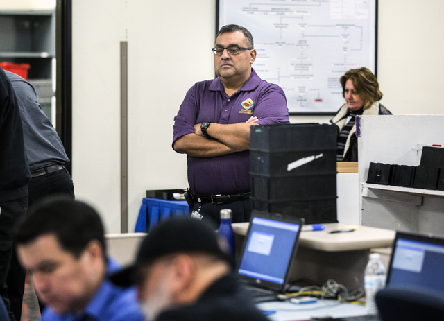 County Registrar of Voters Joe Gloria monitors activity  during a voter recount at the Clark County Election Department office, 965 Trade Drive in North Las Vegas, on Monday, Dec. 7, 2016. The rec ...