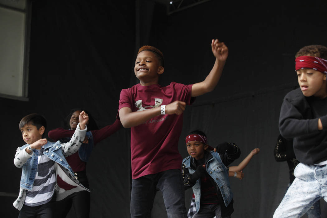Freddy Horne, 10, center, dances as part of the Hypnotic dance crew at the RHXTHM Project at the Las Vegas Tap Festival on Sunday, May 7, 2017, at Craig Ranch Regional Park in Las Vegas. Rachel As ...