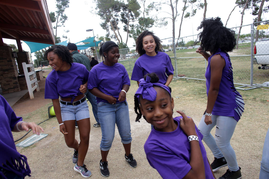 Semiah Taylor, 14, Jaylynn Ridgeway, 15, Marian Parnell, 12, Amari Washington, 16, and Sekia Taylor, 10, in the foreground, dance backstage before performing at the Las Vegas Tap Festival on Sunda ...