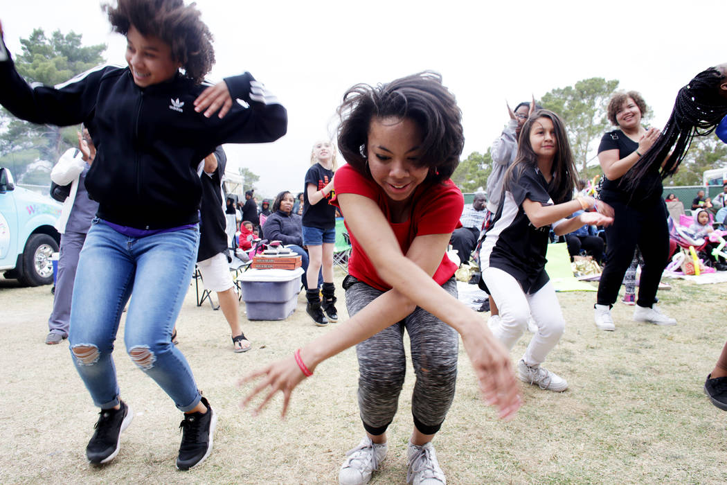 Marian Parnell, 12, from left, Diana Fleming, 13, and Elizabeth Mahavong, 10, dance in front of the stage at the RHXTHM Project stage at the Las Vegas Tap Festival on Sunday, May 7, 2017, at Craig ...