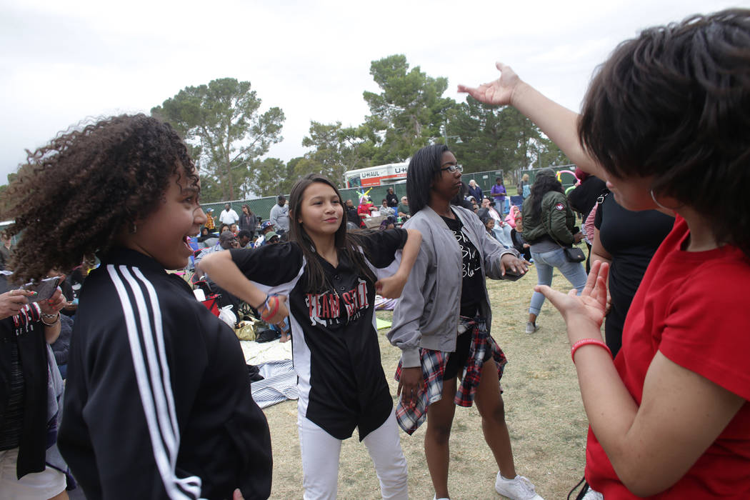Marian Parnell, 12, from left, Elizabeth Mahavong, 10, Iyonna Harrison, 17, and Diana Fleming, 13, dance in front of the stage at the RHXTHM Project stage at the Las Vegas Tap Festival on Sunday,  ...