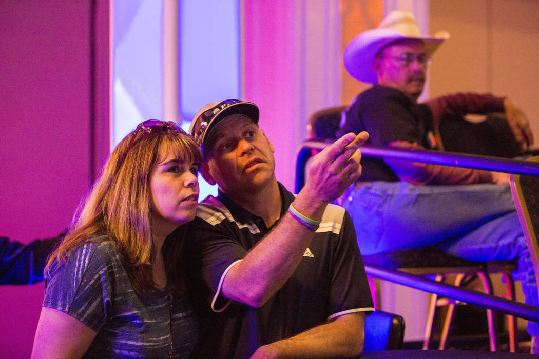 Tracy Ince, left, and Ron Ince, attendees of the American Poolplayers Association 2017 8-Ball Classic Poolplayer Championship,  watch the semifinals at the Westgate hotel-casino in Las Vegas, Sund ...