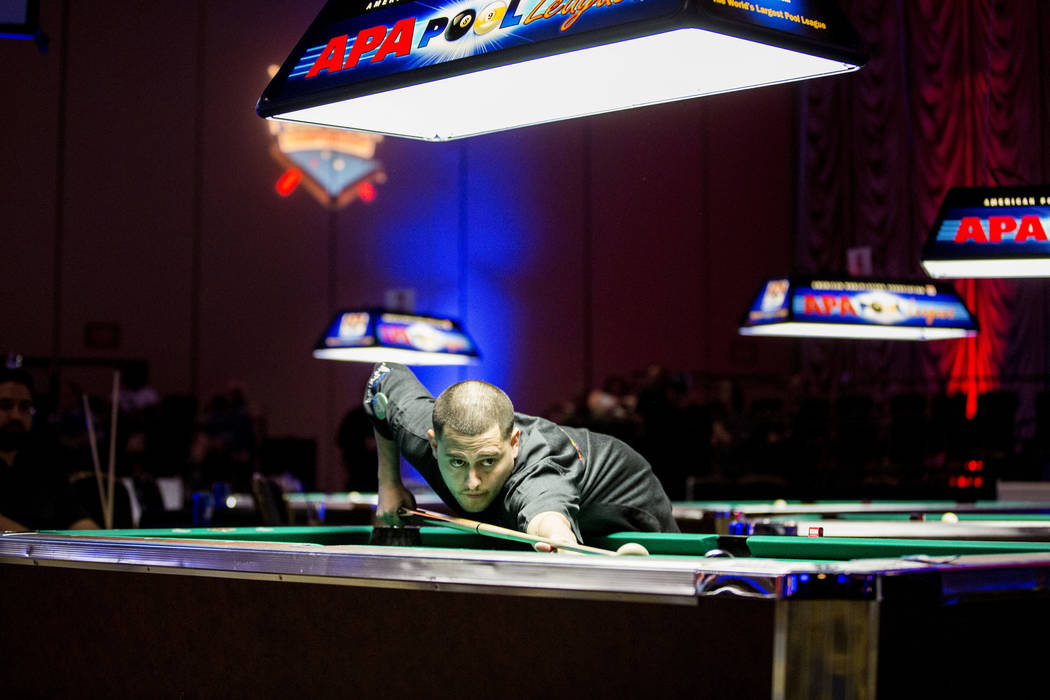 Benjamin Almazan, 8-Ball Classic finalist, plays in the Yellow Tier during the American Poolplayers Association Poolplayer Championship semifinals at the Westgate hotel-casino in Las Vegas, Sunday ...