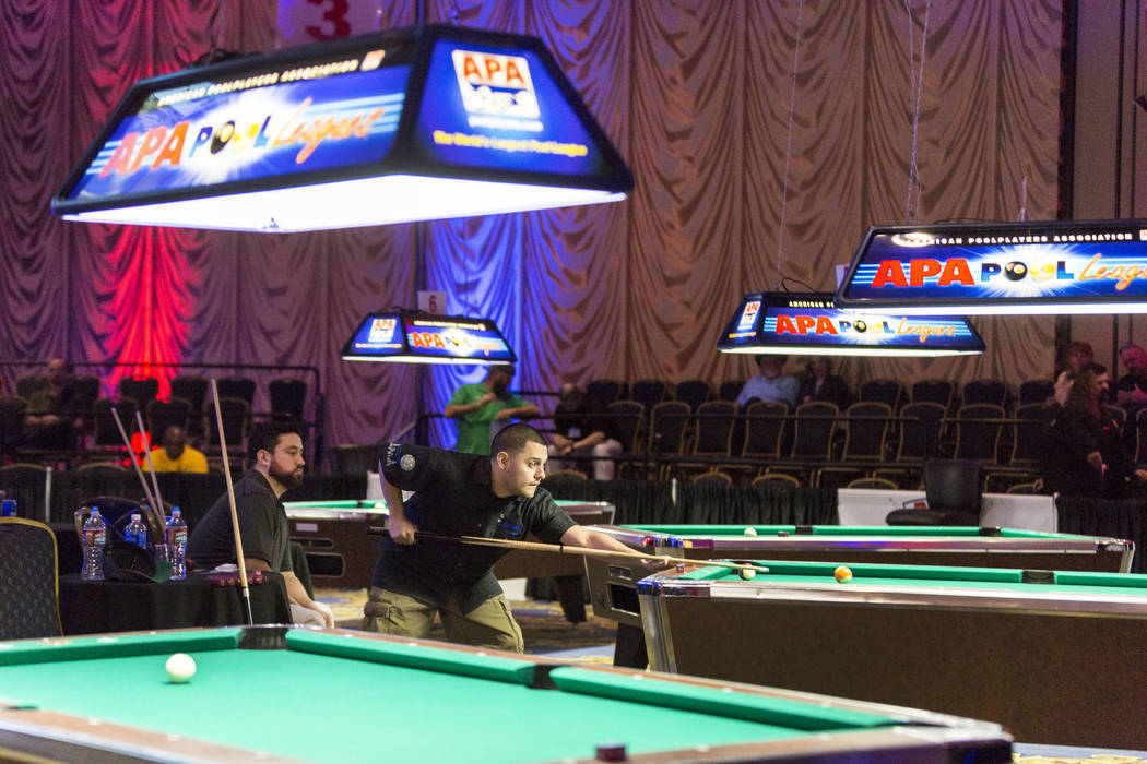 Billards player Edgar Giribaldo, left, and Benjamin Almazan, 8-Ball Classic finalist,  compete in the Yellow Tier during the American Poolplayers Association 2017 Poolplayer Championship semifinal ...