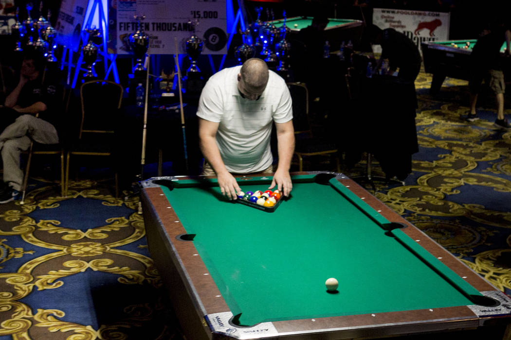 Jimmy James, 8-Ball Classic finalist, plays in the Red Tier during the American Poolplayers Association Poolplayer Championship semifinals at the Westgate hotel-casino in Las Vegas, Sunday, May 7, ...