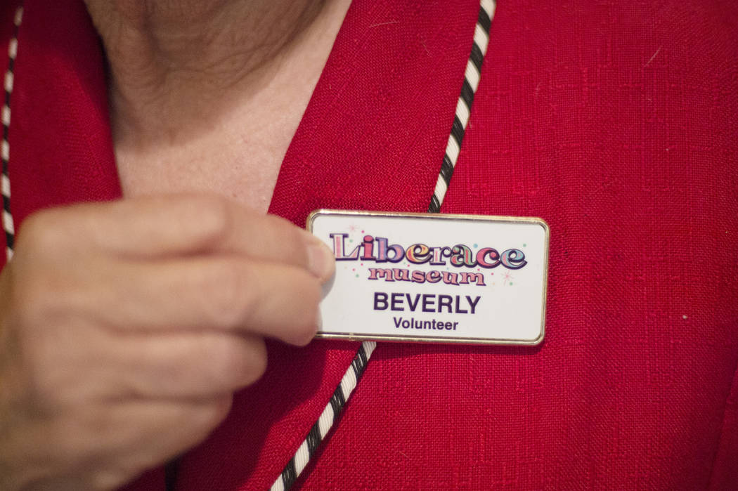 Beverly Saperstein, 80, shows off a badge from her time volunteering at the Liberace Museum at her home on Wednesday, May 3, 2017, in Henderson. Saperstein has been named Nevada Senior Citizen of  ...
