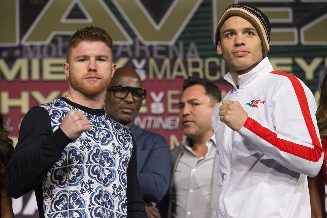"""Saul """"Canelo"""" Alvarez, left, and Julio Cesar Chavez Jr., during their final press conference at MGM Grand hotel-casino on Wednesday, May 3, 2017, in Las Vegas. The two will fight ..."""