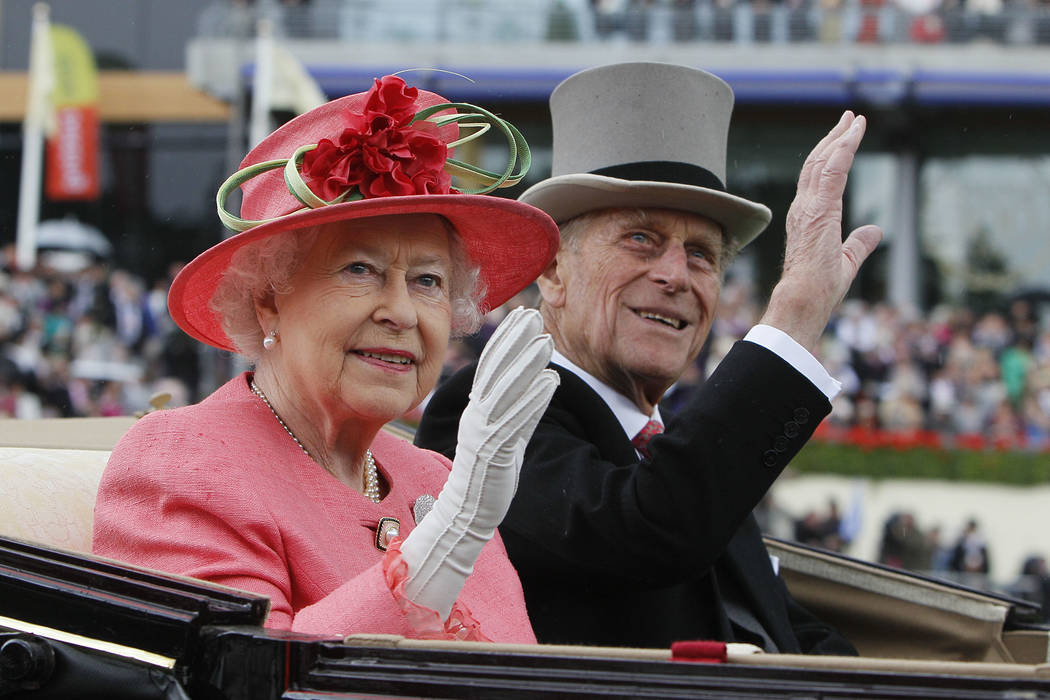 Britain's Queen Elizabeth II with Prince Philip arrive by horse drawn carriage in the parade ring on the third day, traditionally known as Ladies Day, of the Royal Ascot horse race meeting at Asco ...