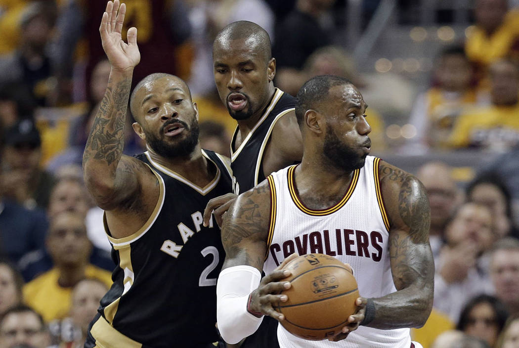 Cleveland Cavaliers' LeBron James, right, works against Toronto Raptors' P.J. Tucker, left, and Serge Ibaka during the first half in Game 2 of a second-round NBA basketball playoff series, Wednesd ...