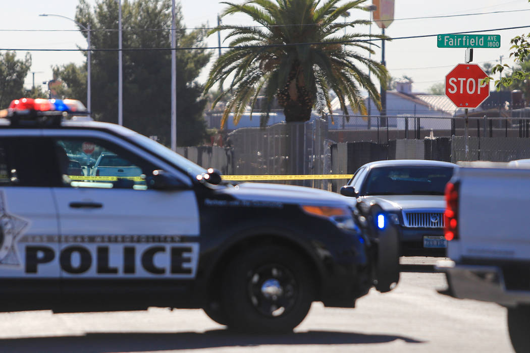 Crime scene tape blocks off the intersection of Chicago Avenue and Fairfield Avenue as police investigate a shooting on Thursday, May 4, 2017, in Las Vegas. Brett Le Blanc Las Vegas Review-Journal ...