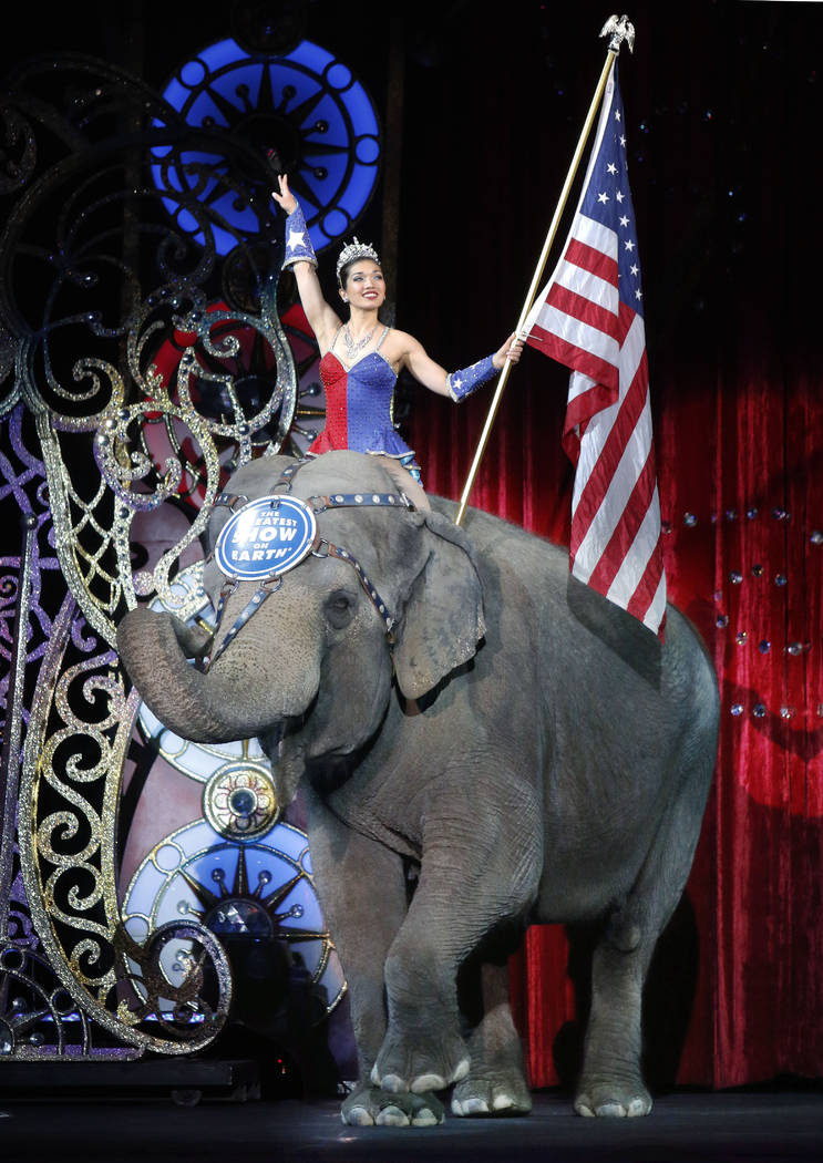 In this May 1, 2016 file photo, an Asian elephant performs during the national anthem for the final time in the Ringling Bros. and Barnum & Bailey Circus in Providence, R.I. The Ringling Bros. ...