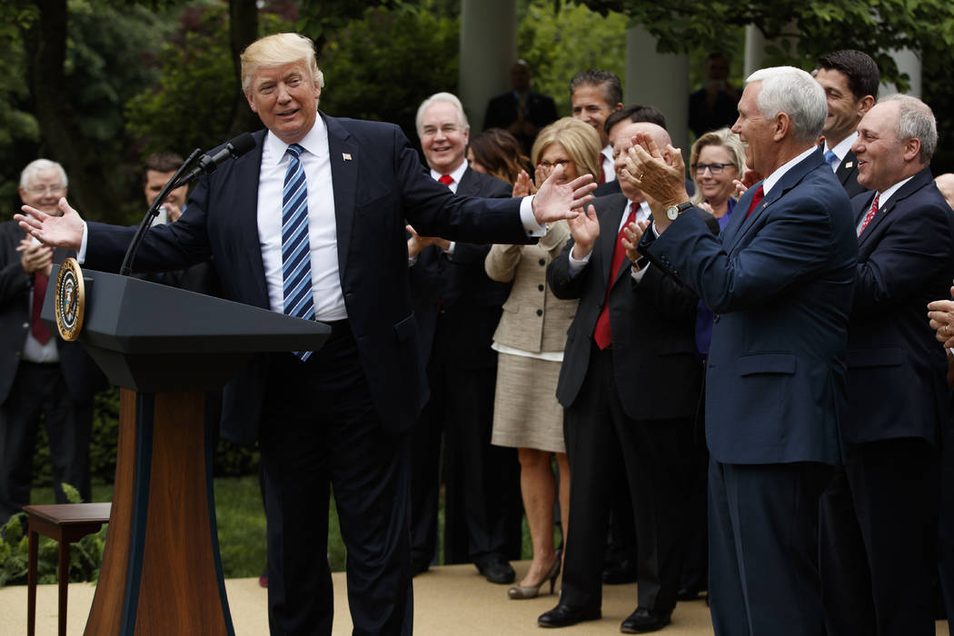 President Donald Trump, accompanied by GOP House members, speaks in the Rose Garden of the White House in Washington, Thursday, May 4, 2017, after the House pushed through a health care bill. (AP  ...