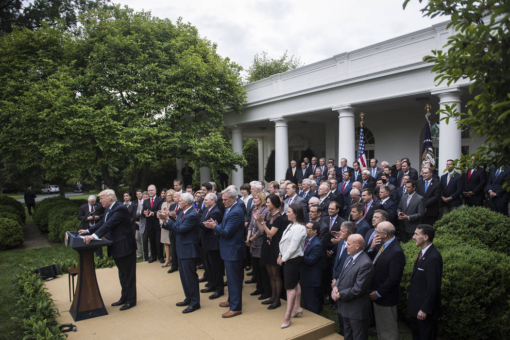 President Donald Trump speaks in the Rose Garden after the House pushed through a health-care bill on Thursday. MUST CREDIT: Washington Post photo by Jabin Botsford