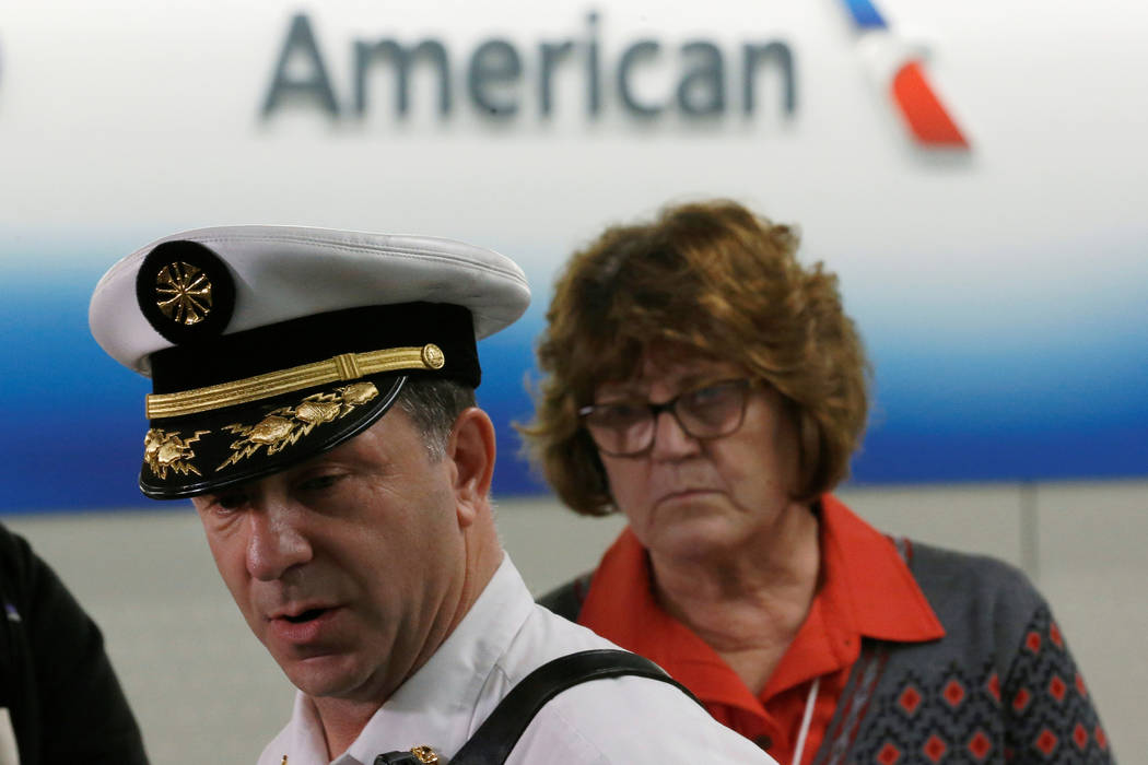 Chicago Fire Department Assistant Deputy Fire Commissioner Timothy Sampey holds a news conference as Aviation Commissioner Ginger Evans looks on at O'Hare International Airport in Chicago, Illinoi ...