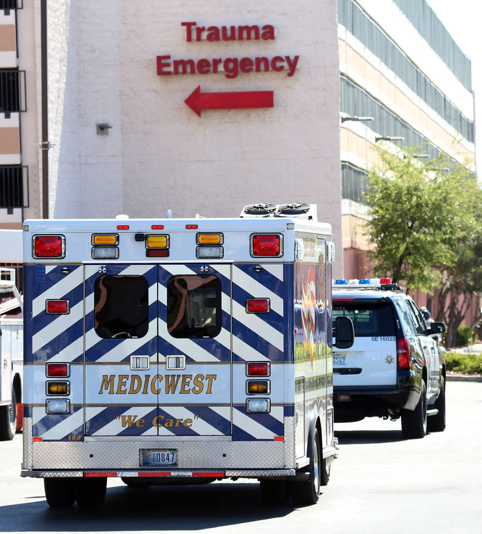 A MedicWest ambulance arrives at Sunrise Hospital on Thursday, May 4, 2017, in Las Vegas. A school bus involved in a crash rolled over near the intersection of Carey Avenue and Nellis Boulevard. B ...