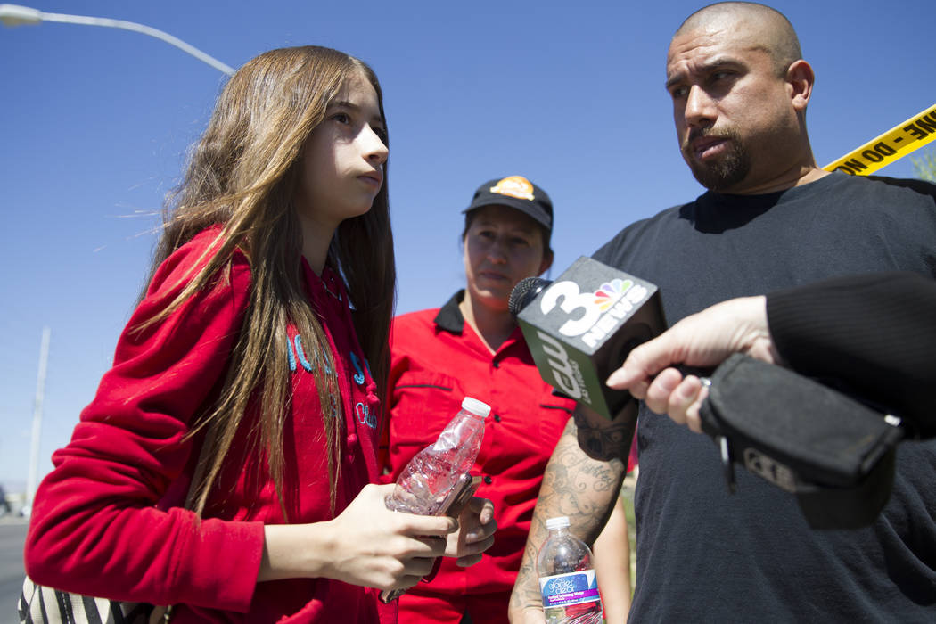 Kristiana Tenchavez, 13, her mother Kristina and father Vincent after she was released on scene of a school bus crash near the intersection of Carey Avenue and Nellis Boulevard on Thursday, May 4, ...