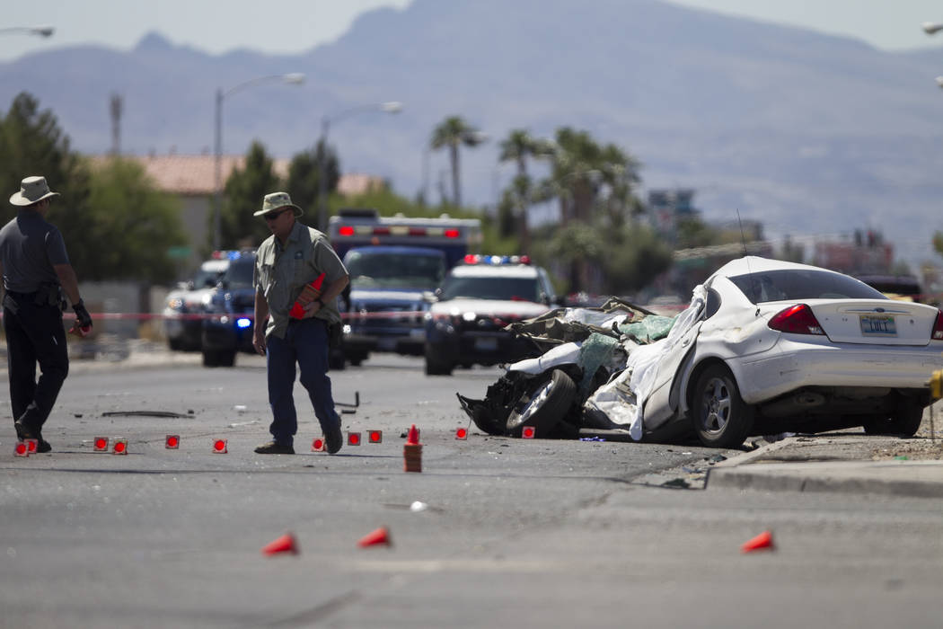 The scene of a fatal car crash involving a passenger vehicle and a school bus at the intersection of Carey Avenue and Nellis Boulevard on Thursday, May 4, 2017, in Las Vegas. Erik Verduzco Las Veg ...