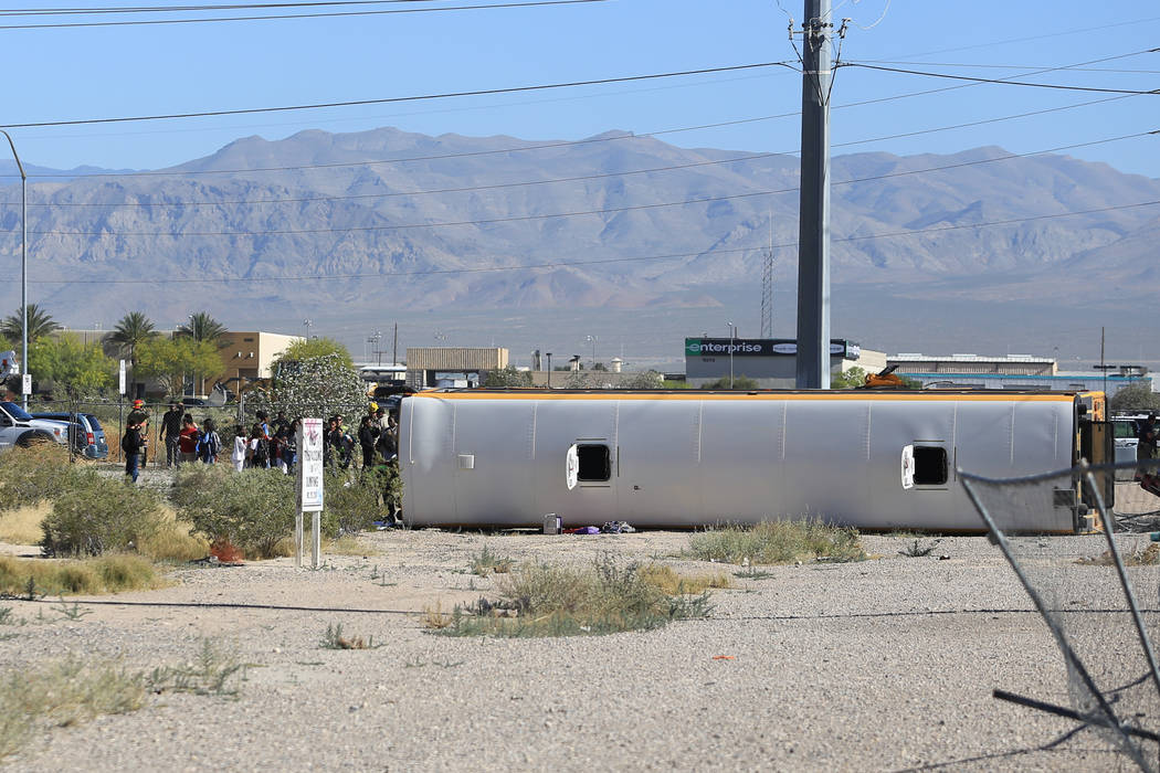 A school bus involved in a crash rolled over near the intersection of Carey Avenue and Nellis Boulevard on Thursday, May 4, 2017, in Las Vegas. Brett Le Blanc Las Vegas Review-Journal @bleblancphoto