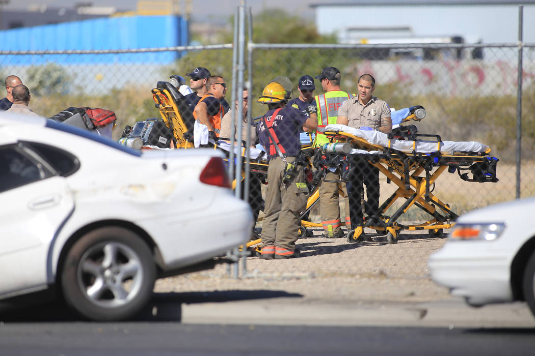 Emergency personnel wait with stretchers after a school bus involved in a crash rolled over on Thursday, May 4, 2017, in Las Vegas. Brett Le Blanc Las Vegas Review-Journal @bleblancphoto