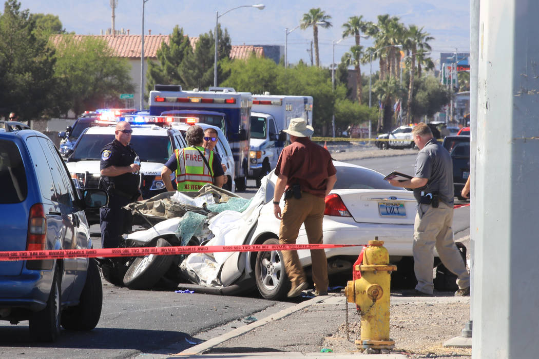 Police inspect the scene of a crash that caused a school bus to roll over on Thursday, May 4, 2017, in Las Vegas. Brett Le Blanc Las Vegas Review-Journal @bleblancphoto
