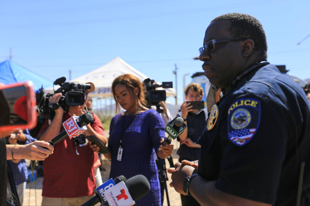 Clark County School District Police Department Capt. Ken Young briefs news outlets on the crash that cause a school bus to roll over on Thursday, May 4, 2017, in Las Vegas. Brett Le Blanc Las Vega ...