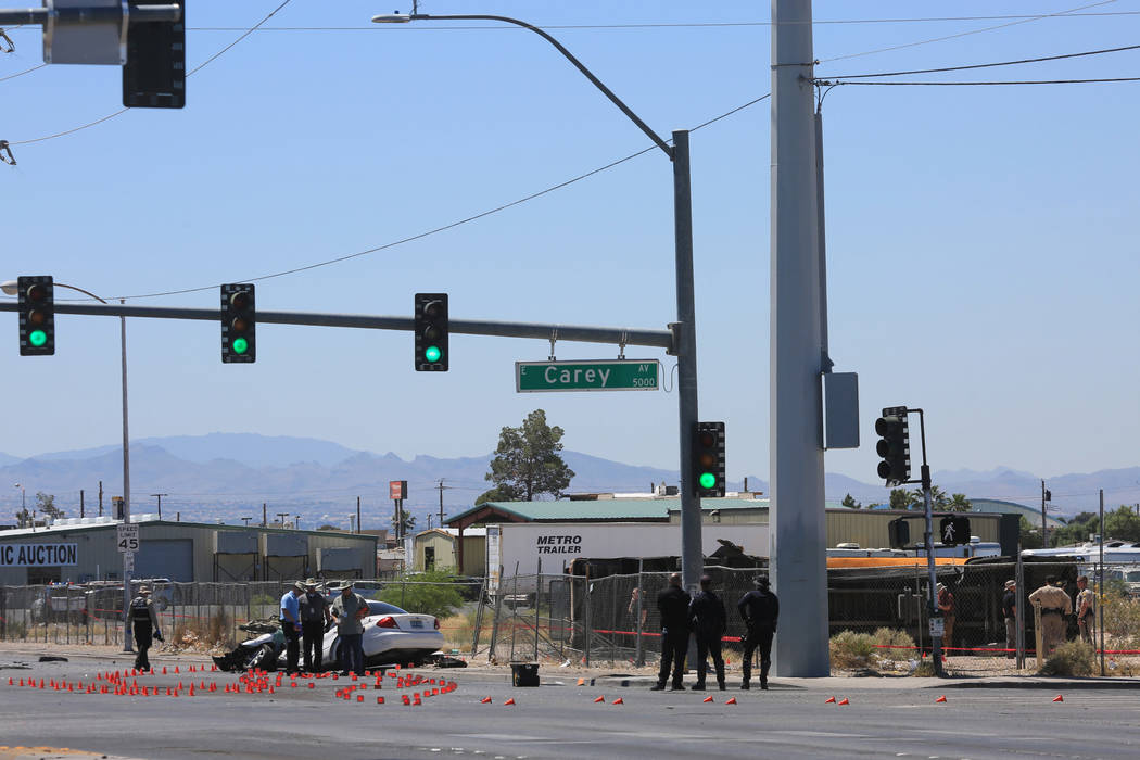 Police investigate a fatal crash that caused a school bus to roll over on Thursday, May 4, 2017, in Las Vegas. There were no fatalities on the school bus. Brett Le Blanc Las Vegas Review-Journal @ ...