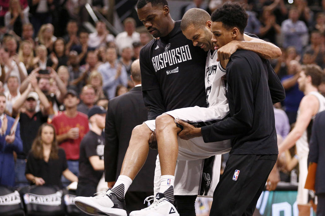 May 3, 2017; San Antonio, TX, USA; San Antonio Spurs point guard Tony Parker (9) is helped off the court after being injured against the Houston Rockets during the second half in game two of the s ...