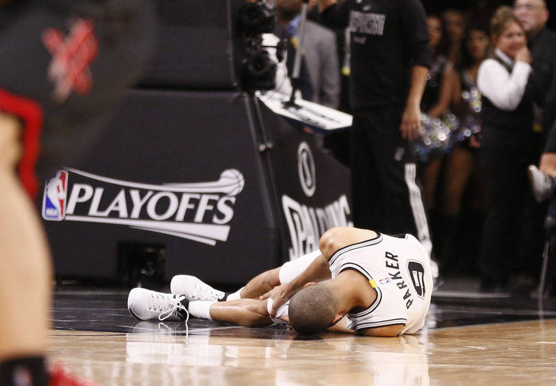 May 3, 2017; San Antonio, TX, USA; San Antonio Spurs point guard Tony Parker (9) rests on the court after being injured against the Houston Rockets during the second half in game two of the second ...