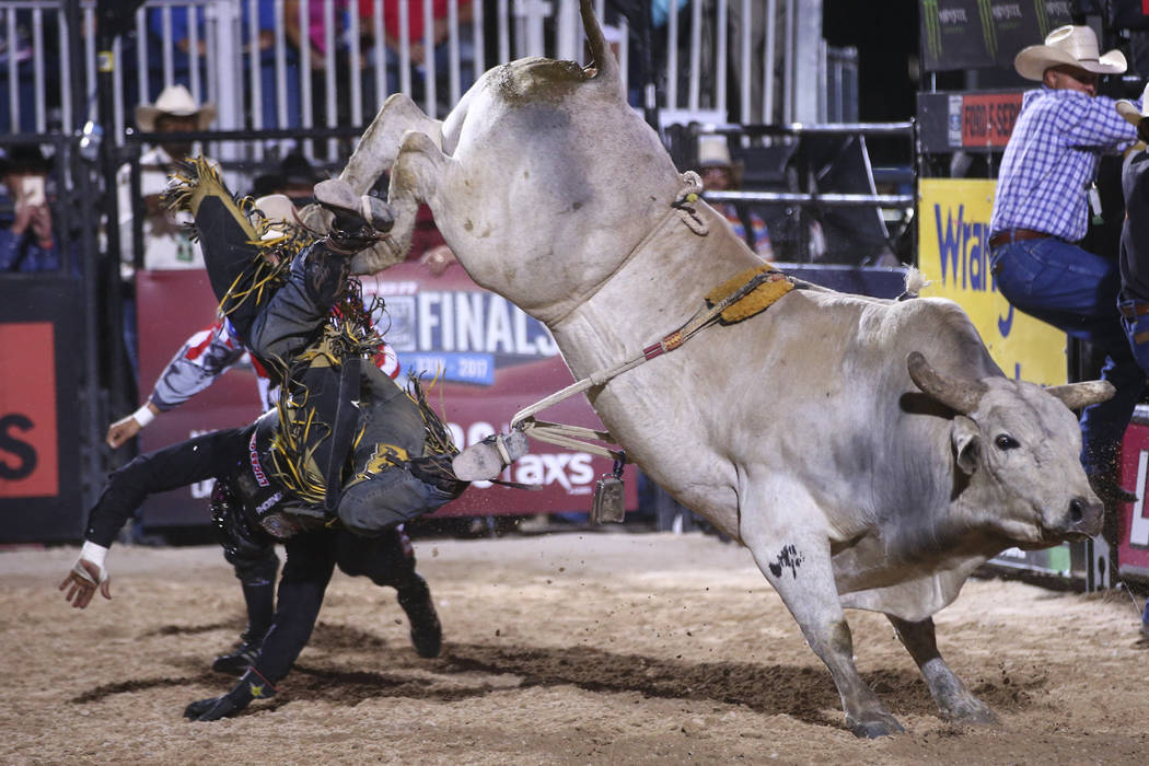 Shane Proctor is bucked off by Milky Jones during the Professional Bull Riders Last Cowboy Standing event at Las Vegas Village in Las Vegas on Saturday, May 13, 2017. Chase Stevens Las Vegas Revie ...