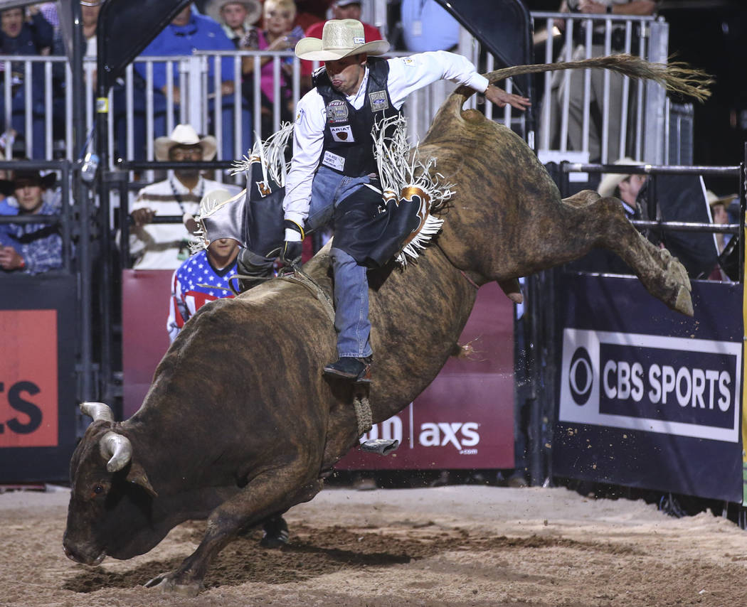 Marco Antonio Eguchi rides Crazy Horse during the Professional Bull Riders Last Cowboy Standing event at Las Vegas Village in Las Vegas on Saturday, May 13, 2017. Chase Stevens Las Vegas Review-Jo ...