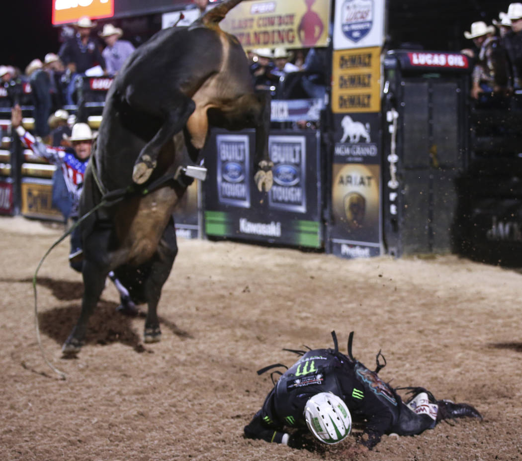 Gage Gay is knocked off of Tractor Tippin during the Professional Bull Riders Last Cowboy Standing event at Las Vegas Village in Las Vegas on Saturday, May 13, 2017. Chase Stevens Las Vegas Review ...