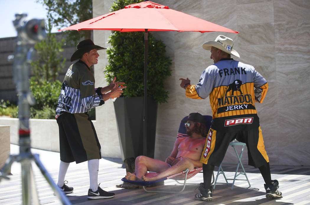 Professional Bull Riders bullfighter Cody Webster, left, and Frank Newsom film a promotional advertisement with Dale Brisby for sponsor Matador Jerky at UFC's corporate headquarters in Las Vegas o ...