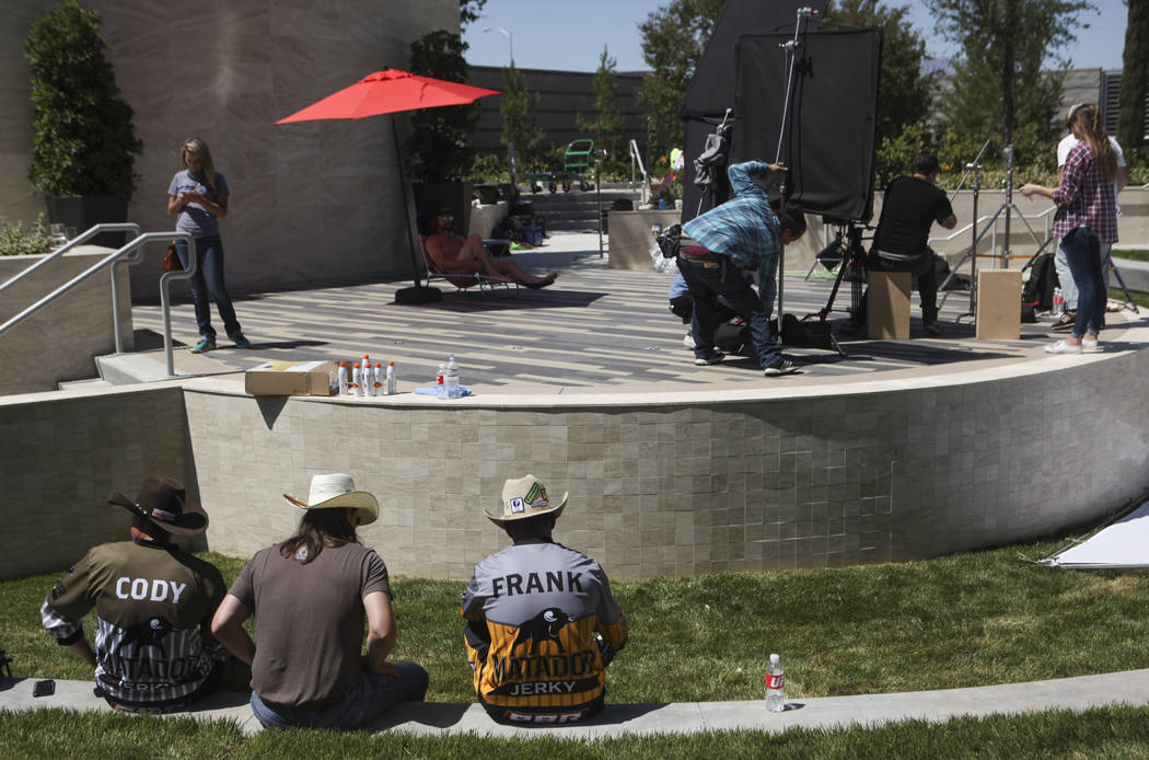 Professional Bull Riders bullfighter Cody Webster, left, and Frank Newsom take a break while filming a promotional advertisement for sponsor Matador Jerky at UFC's corporate headquarters in Las Ve ...
