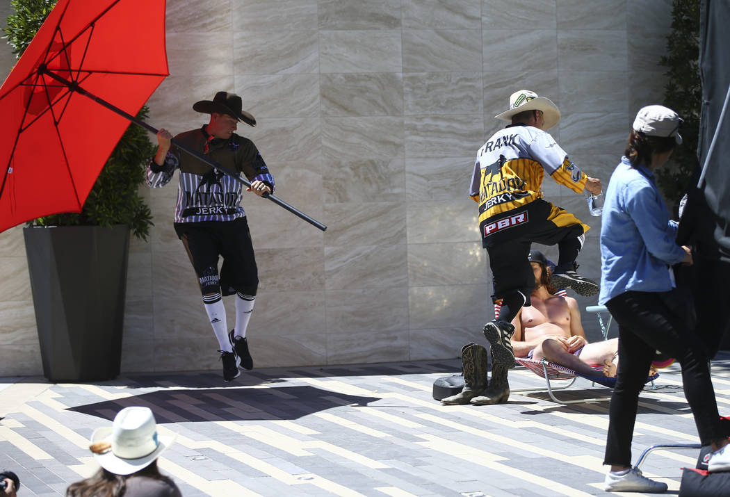 Professional Bull Riders bullfighters Cody Webster, left, and Frank Newsom while film a promotional advertisement with Dale Brisby for sponsor Matador Jerky at UFC's corporate headquarters in Las  ...