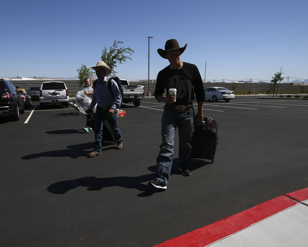 Professional Bull Riders bullfighters Cody Webster, left, and Frank Newsom film a promotional advertisement with Dale Brisby for sponsor Matador Jerky at UFC's corporate headquarters in Las Vegas  ...