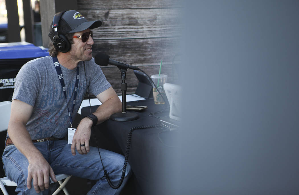 "Professional Bull Riders bullfighter Seth ""Shorty"" Gorham, left, gets ready for an interview with Graham Bunn of Go Country 105, a Los Angeles-based radio station, ahead of the P ..."