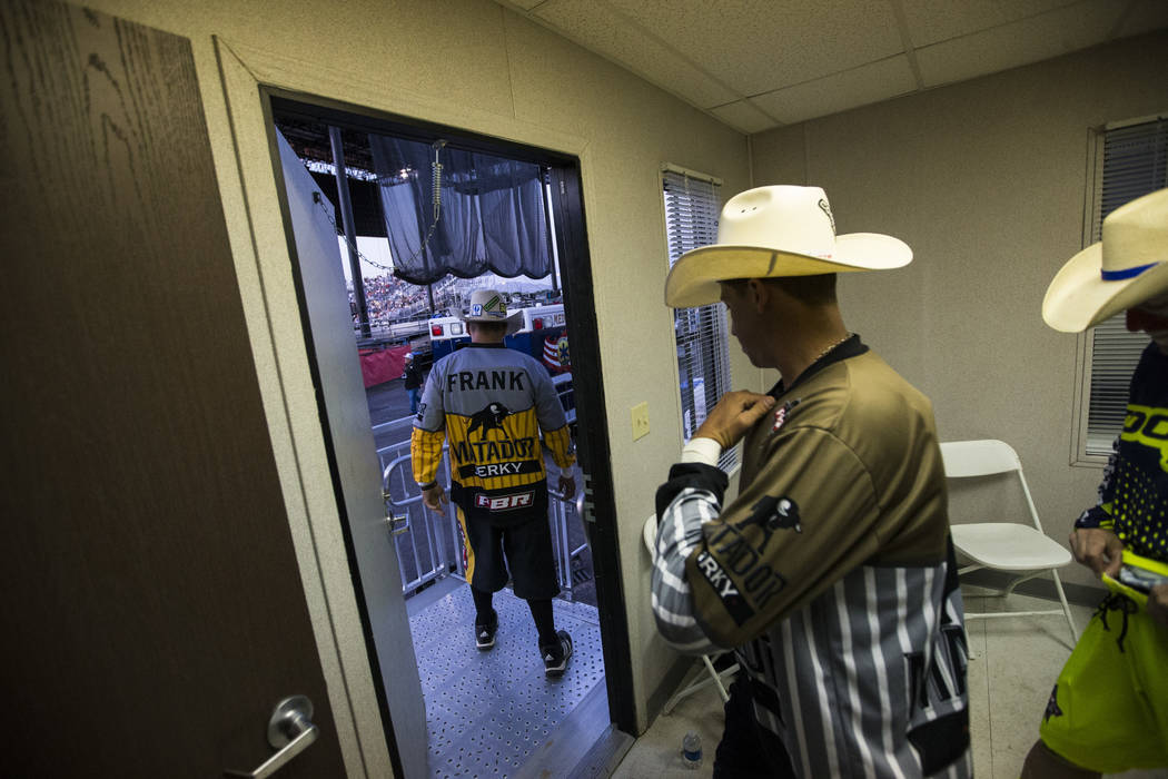 Professional Bull Riders bullfighters Frank Newsom, left, and Cody Webster head out for the Last Cowboy Standing event at Las Vegas Village in Las Vegas on Friday, May 12, 2017. Chase Stevens Las  ...