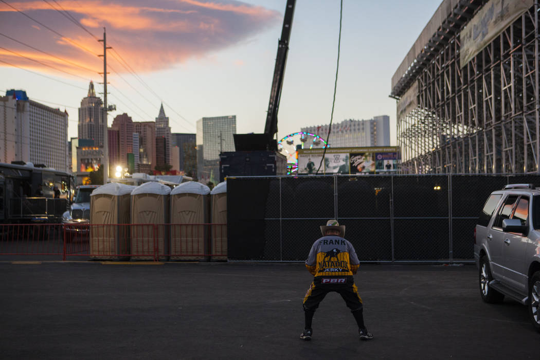 Professional Bull Riders bullfighter Frank Newsom stretches before the Last Cowboy Standing event at Las Vegas Village in Las Vegas on Friday, May 12, 2017. Chase Stevens Las Vegas Review-Journal  ...