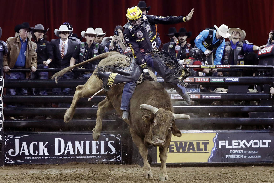 Matt Triplett, from Columbia Falls. Mont., rides Little Red Jacket during the Professional Bull Riders Buck Off at New York's Madison Square Garden, Friday, Jan. 6, 2017. (AP Photo/Richard Drew) T ...