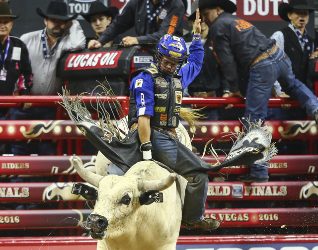 Kaique Pacheco rides Crossed Fingers while competing during the championship round of the Professional Bull Riders World Finals at the T-Mobile Arena in Las Vegas on Sunday, Nov. 6, 2016. Chase St ...