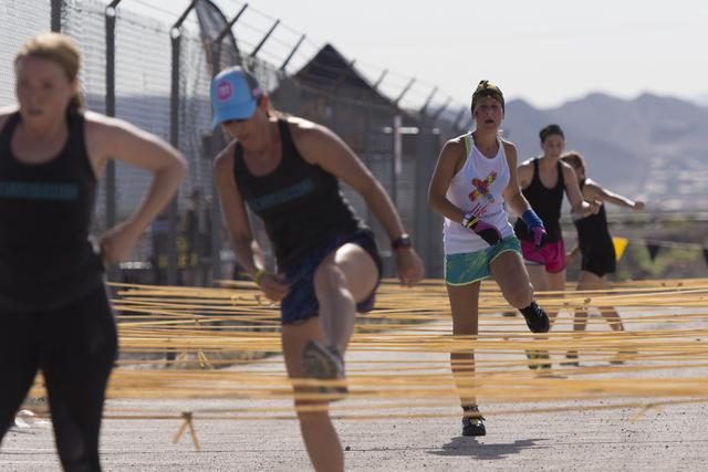 Runners negotiate the course during the Badass Dash at Sam Boyd Stadium in Las Vegas on Saturday, May 28, 2016.  (Jason Ogulnik/Las Vegas Review-Journal)