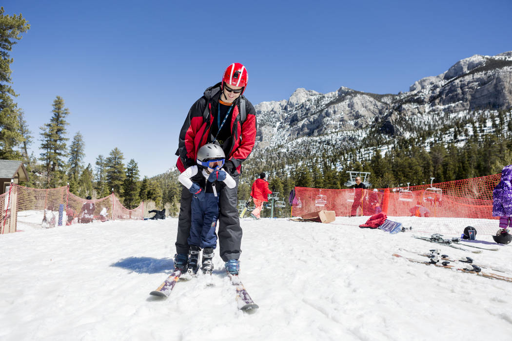 Christopher Ix skis with his son Will, 3, during the final day of the 2016-17 season at Lee Canyon in Las Vegas, Sunday, April 2, 2017. (Elizabeth Brumley Las Vegas Review-Journal) @EliPagePhoto