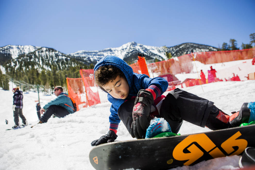 "Gavin Reese, 5, straps up to ride down a slope during the final day of the 2016-17 season at Lee Canyon in Las Vegas, Sunday, April 2, 2017. ""I'm not afraid at all."" (Elizabeth B ..."