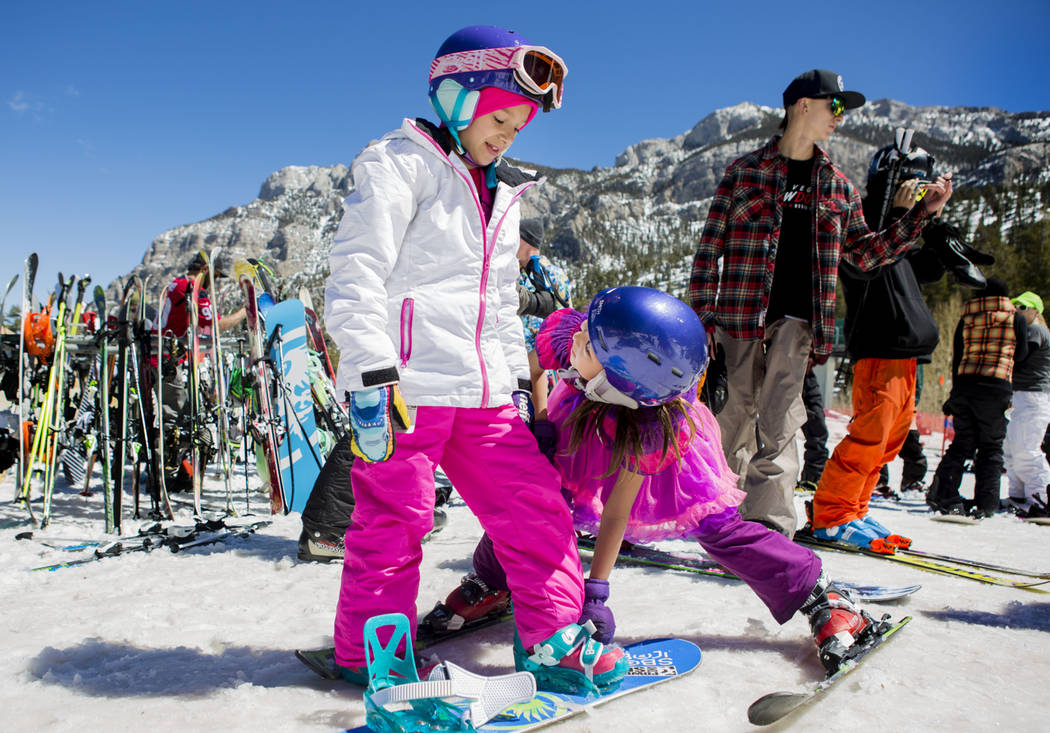 Tatym Pfalher, 8, left, Nayeli Estrda, 9, get ready to go down a slope during the final day of the 2016-17 season at Lee Canyon in Las Vegas, Sunday, April 2, 2017. (Elizabeth Brumley Las Vegas Re ...