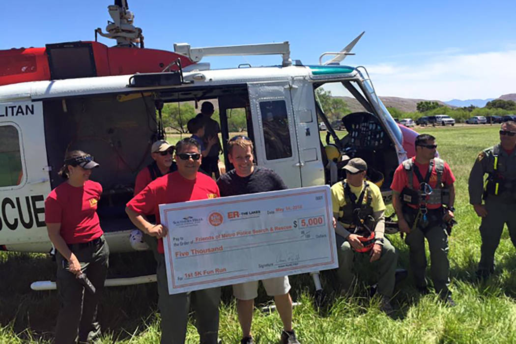 A check is presented to Friends of Metro Police Search and Rescue at the Friends of Metro Search and Rescue 5K at Spring Mountain Ranch State Park on May 14, 2016. (Metro Search and Rescue)
